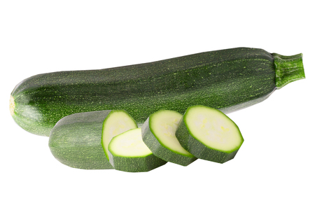 Isolated zucchini. One whole zucchini and slices isolated on white background with clipping path