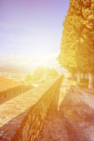 Strolling in the spacious gardens within the walls of Castle of Brescia, Italy. Archivio Fotografico