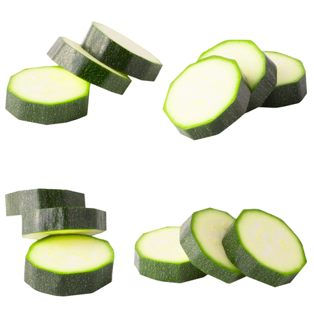 Isolated zucchini. Collection of isolated zucchini on white background with clipping path for package design. Archivio Fotografico