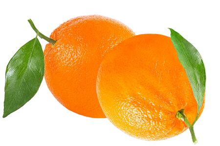 Isolated oranges. Two oranges with leaf isolated on white background with clipping path as packaging design element. Archivio Fotografico