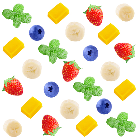 Colorful fruit pattern of fresh strawberry, banana, mango , blueberries and mint slices on white background. From top view