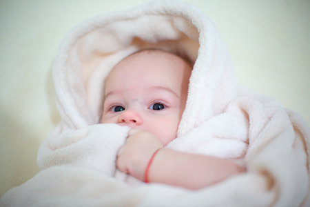 Happy baby boy wrapped towel after bath. Closeup portrait. Archivio Fotografico - 96373587