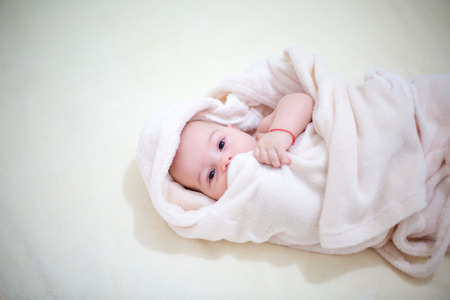 cute baby wrapped towel after bathing. Closeup portrait. Archivio Fotografico - 96374905