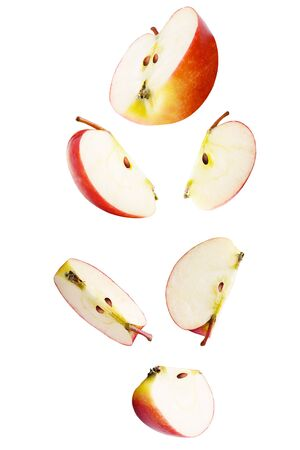 Isolated falling fruits. Falling sliced apple fruit isolated on white background with clipping path as package design element. Archivio Fotografico