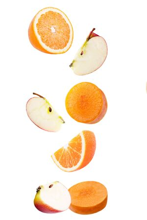 Isolated falling fruits. Falling apple, orange and carrot isolated on white background  as package design element.