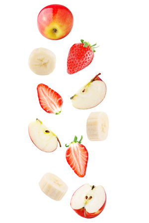 Isolated falling fruits. Falling apple, banana and strawberry fruit isolated on white background Archivio Fotografico - 99092703