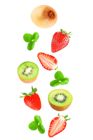 Isolated flying fruits. Falling kiwi and strawberry isolated on white background with clipping path as a packaging design and advertising. Archivio Fotografico - 99206960
