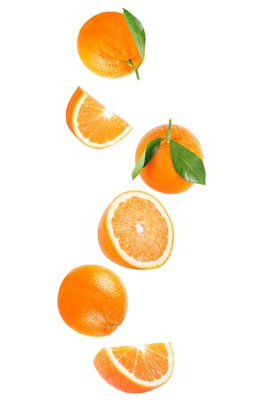 Isolated flying fruits. Isolated falling orange fruit on white background with clipping path as package design element and advertising. Archivio Fotografico - 99206977