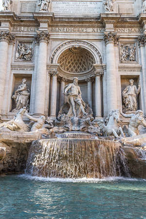 Trevi Fountain in Rome, Italy. Famous landmark fountain di Trevi close up front view of facade and statues. Stock Photo