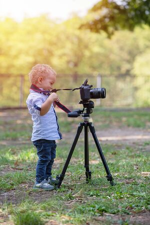 A two years old boy is photographer.