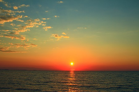 Bright sunset with yellow sun under the sea surface