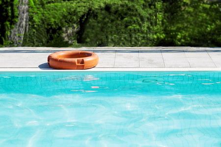 A life buoy for safety on the edge of pool 写真素材
