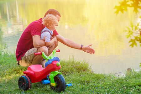 Cute little kid boy and father having fun at park. Active leisure with kids outdoor.