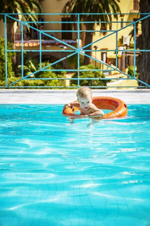 Enjoying the good weather in summertime relaxing in swimming pool. Vacation concept. Zdjęcie Seryjne