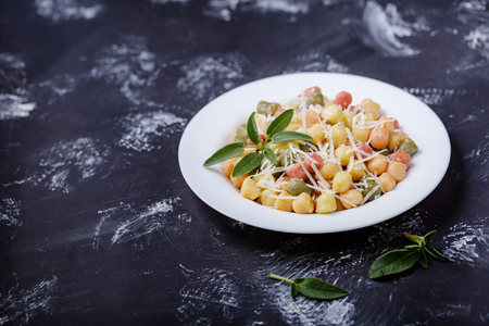 Classic italian lunch with Gnocchi with sage, butter and Parmesa Foto de archivo
