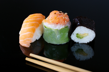 Fresh seafood sushi meal on darck background