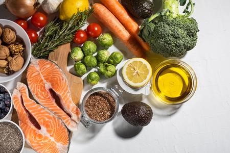 Background of healthy food with salmon, vegetables and superfood. Soft focus, Free copy space. Clean eating and keto diet concept.