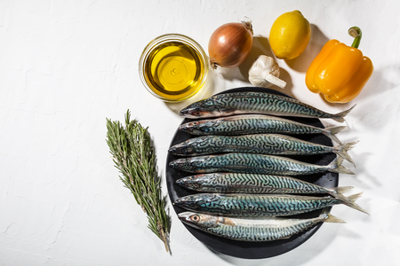 Background of healthy food with blue fish and vegetables and superfood. Soft focus, Free copy space. Reklamní fotografie