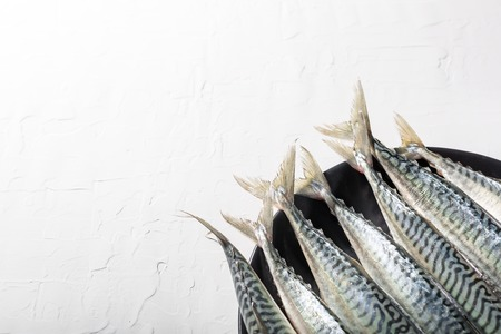 Background of healthy food with raw fresh blue fish. Soft focus, Free copy space.