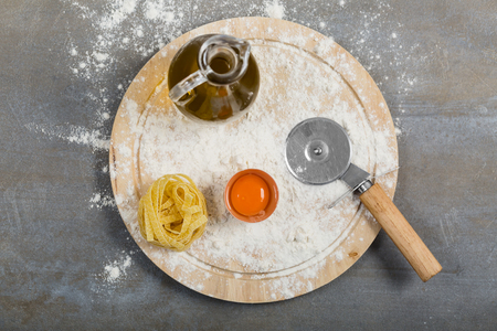 Fresh homemade pasta tagliatelle made with flour, eggs and water. Italian cuisine concept.