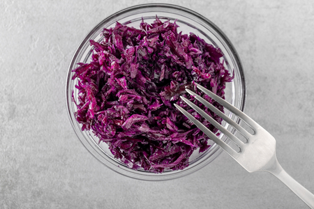 Homemade fermented cabbage. Vegan salad rustic style glass jar. Concept of Probiotic foods favorable for a good health. Top view with copy space. Selective focus.