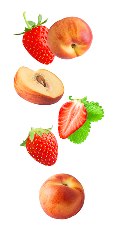 Flying fresh slice peach and strawberry fruits