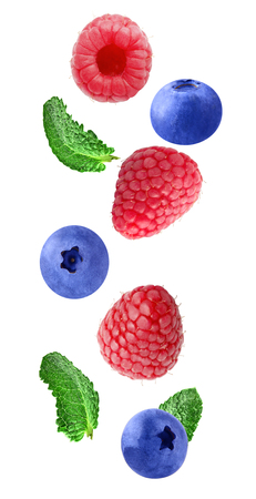 Flying raspberry and blueberry fruits
