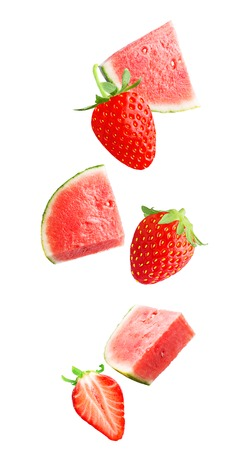 Flying slice watermelon and strawberry fruits