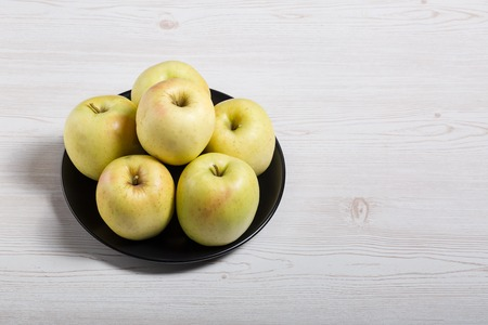 Raw delicious apples golden on wood background 写真素材