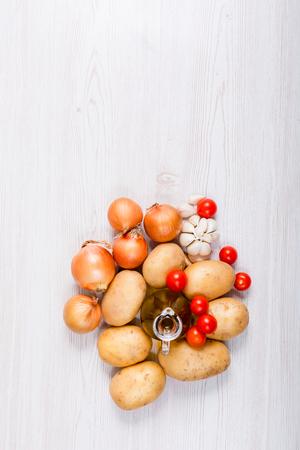 Fresh vegetables ingredients on white wood background 写真素材