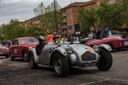Brescia, Italy - May 18, 2019: Triumphant entry of the classic Italian race with vintage cars Archivio Fotografico - 132493758