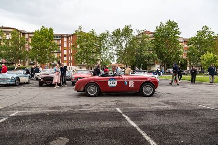 Brescia, Italy - May 18, 2019: Triumphant entry of the classic Italian race with vintage cars Archivio Fotografico - 132493761