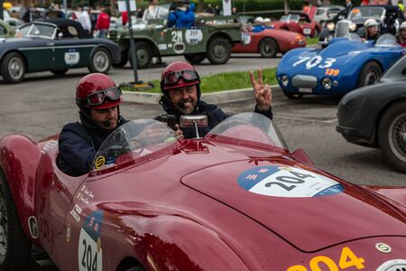 Brescia, Italy - May 18, 2019: Triumphant entry of the classic Italian race with vintage cars Archivio Fotografico - 132493765