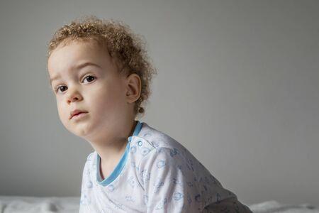 Portrait of little boy in pyjamas before going to sleep Archivio Fotografico - 127506363