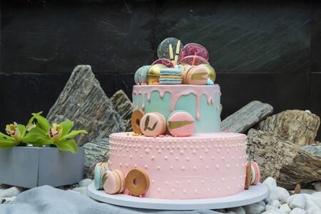 Colorful homemade macarons cake on pyramid in many levels Archivio Fotografico - 127506825