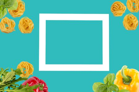 Italian tagliatele pasta with peppers, rocket leaves, basil on pastel cyan background, with light square for copy space. Food minimal concept. flat lay. Archivio Fotografico - 127507141