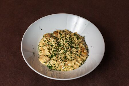 Italian Risotto with mushrooms on a dark background, soft and selective focus. Archivio Fotografico - 127507156