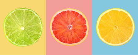 Composition of slices citrus fruits on colored background Archivio Fotografico - 129244818