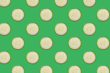 Food pattern. Cucumbers texture on green pastel background. From top view. full depth of field. Archivio Fotografico - 129244826