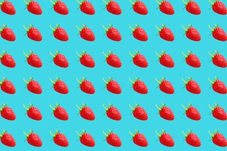 Fruit pattern. Strawberries texture on light blue pastel background. From top view. full depth of field. Archivio Fotografico - 129244822