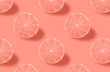 Pastel pink lemon fruits pattern on coral background. Minimal summer food concept. From top view. full depth of field. Archivio Fotografico - 129247176