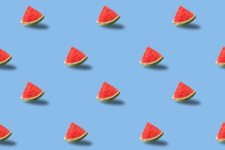 Trendy sunlight Fruit pattern made with red watermelon slice on bright light blue background. Minimal summer concept. Archivio Fotografico - 129247897