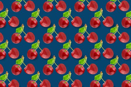 Flat lay fruit pattern of fresh cherries on blue background. Minimal summer fruits pattern for blog or recipe book Archivio Fotografico - 129248466