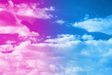 Close-up of clouds painted in neon light in minimal style. Copy space, vacation concept.