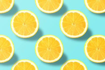 Vivid fruit pattern of fresh lemon on colourful background