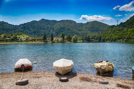 Landscape View on Lake Idro in Brescia Province, Lombardy, Italy. Summer vacation for tourists on rich resort in Italy.