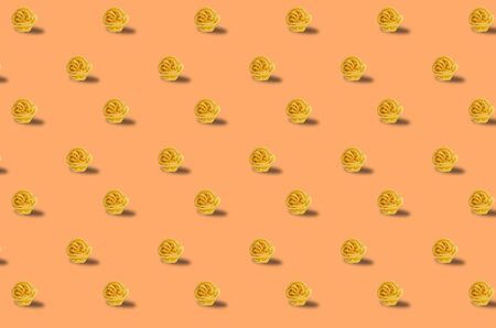 Trendy pattern done with raw pasta background Stock Photo