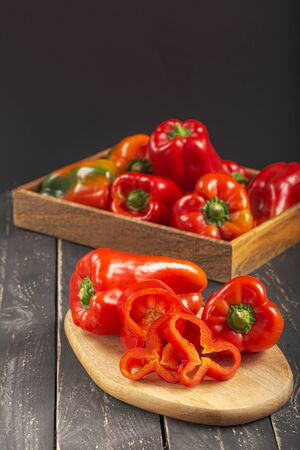 Organic sweet red peppers ready to eat. Concept of healthy food with raw vegetables. Selective focus. Copy space. Archivio Fotografico - 132917294