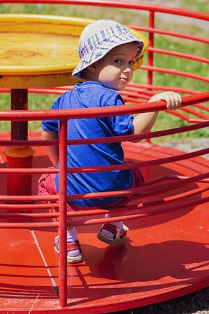 Cute baby boy 3 year old who is playing on park games. Outdoor. Childhood concept.