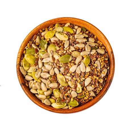 Mixed pumpkin, sunflower, flaxseed, sesame seeds isolated on white with clipping path as package design element and advertising. full depth of field. Professional studio photo.